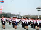 PYONGYANG - MARCH 23: Korean pioneer kids during military parade on March 23, 2010 in Pyongyang, North Korea