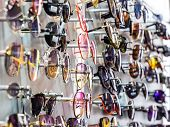 Sunglasses On The Stand At The Counter. Sunglasses For Sale. poster