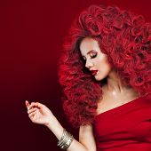 Portrait Of Beautiful Young Woman With Red Hair On Red Background. Glamorous Girl In Red poster