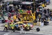 HAMPTON, GA - MAR 7: Kyle Busch makes a quick pit stop during the running of the Kobalt Tools 500 at