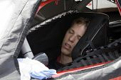 LONG POND, PA - JUNE 06:  Brad Keselowski takes a nap during the rain delay for the Gillette Fusion