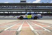INDIANAPOLIS, IN - JULY 23:  Jimmie Johnson brings his Lowe's Chevrolet down pit road for the Bricky