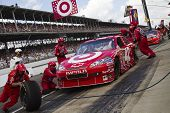 INDIANAPOLIS, IN - JULY 25:  Juan Pablo Montoya makes a pit stop for the Brickyard 400 race at the I