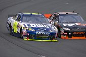 LOUDON, NH - SEP 18:  Jimmie Johnson brings his Lowe's Chevrolet through the turns during practice f