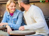 Couple In Love Sit Cafe Terrace. Man With Beard And Blonde Woman Cuddle On Romantic Date. Romance Co poster