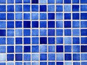 Small square blue tiles abstract pattern background.