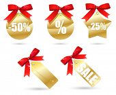 set of golden sales labels with red bow