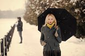 Woman With Long Blond Hair On White Snow Landscape. Model In Grey Coat, Scarf And Mittens. Holidays  poster