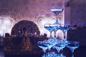 Awesome Shot Of Glittering 3-tier Champagne Tower At The Decorated Banquet Hall Background. Beautifu poster