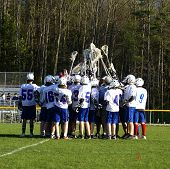 stock photo of lax  - a high school lacrosse team at a match - JPG
