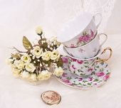 Vintage elegant cups with cameo and flowers