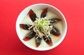 picture of potash  - a bowl of rice porridge with chicken and potash preserved egg