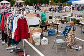 Shoppers Pick Through Merchandise At City Garage Sale