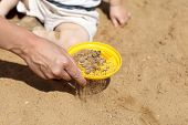 Sifting Sand In Sandbox