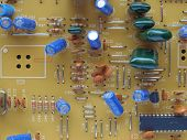 stock photo of potentiometer  - Detail of an electronic printed circuit board - JPG