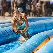 Boise, Idaho/usa - August 25 - Unidentified Woman Jumps To Go Down The Slide. The Dirty Dash Is A 10