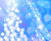 stock photo of christmas lights  - Blurred christmas lights forming a tree on a blue background - JPG