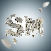 picture of sm  - SM explosion as smashed and broken into silver pieces word depth dimensional background - JPG