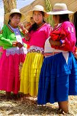 women in traditional dresses