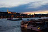 Colorful Sunset In Budapest With A Panoramic View Of The River Danube And The Fishermans Bastion.