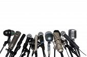 stock photo of microphone  - Various microphones aligned at press conference isolated over a white background - JPG