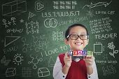 foto of vest  - Portrait of asian elementary school student showing LEARN word in class - JPG