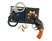 Gun, Badge And Handcuffs