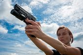 Young Girl With Gun