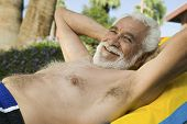 Senior Man Lying on sunlounger portrait.