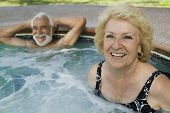 Senior Couple in Hot Tub portrait.