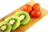 Kiwifruit Slices Into Pieces And Three Tomato.
