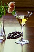 Garnet Necklace And Glass With White Wine