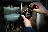 stock photo of electricity meter  - The electrician changes the old electric meter for the new - JPG