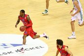MOSCOW - SEP 29: Sportsman from CSKA Moscow (Russia, in red) teams dribbles basketball game in tourn