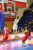 MOSCOW - SEP 29: Athlete from Zalgiris (Lithuania, in white) team throws ball into basketball hoop i