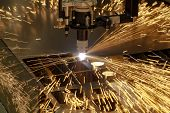 stock photo of sparking  - Plasma cutting metalwork industry machine with sparks - JPG