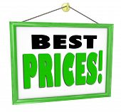 The words Best Prices on a sign hanging in a store window advdertising lowest cheapest costs around