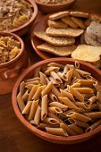 picture of carbohydrate  - Whole grain carbohydrates on wooden table with studio lighting - JPG