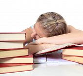 Attractive young scandinavian woman is taking a nap on her study documents. All on white background.