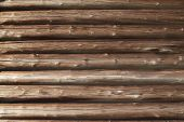 stock photo of log cabin  - Closeup of old cracked log wall - JPG