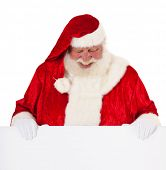 Santa Claus standing behind blank sign. All on white background.