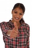 Portrait of an attractive girl showing thumbs up. All on white background.