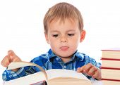 Cute little boy reading book. All on white background.