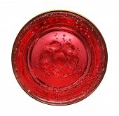 close-up view from above on glass with red aerated water