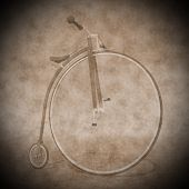 stock photo of penny-farthing  - Beautiful penny farthing bicycle with one big front wheel in the street - JPG