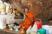 Buddhist Monk Prays