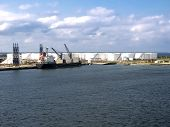 picture of fuel tanker  - Oil Tanker Offloading to Refinery Storage Tanks - JPG