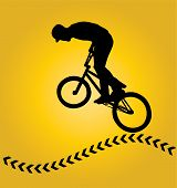 Bmx rider cyclist silhouette isolated on yellow
