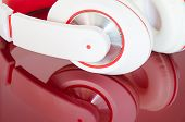 White Red Headphones On Vinous Surface