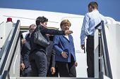 BERLIN, GERMANY - MAY 20, 2014: German Chancellor Angela Merkel down the ladder Airbus A350 XWB during open up the International aviation and space exhibition ILA.